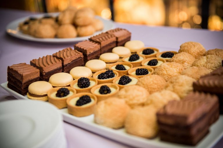 a dessert tray that has fudge and various fancy cookies