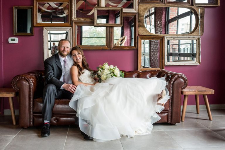 married couple wedding picture on a leather couch